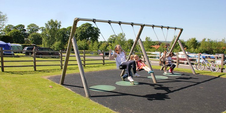 Fun on the swings at Robin Hood Caravan Park