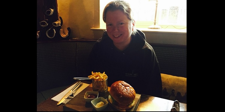 Beki enjoying a burger in Wombleton
